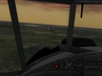 Looking out the cockpit of the An-2 in flight