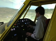 A customer flying the AT-802 simulator in X-Plane. This shows the juncture of the center and right-hand side projected images.