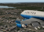 The stock 747 landing in Queens, NY. Shown with the UrbanMAXX Extreme scenery add-on. Image courtesy of AVSIM Online and Comanche.