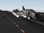An F-4 Phantom II, taking off from a carrier