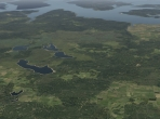 Forests, fields, and lakes meet in X-Plane 10
