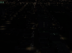 An X-Plane 10 freeway, seen at a distance at night