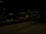An X-Plane 10 freeway, seen at night