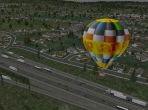 A hot air balloon in the suburbs